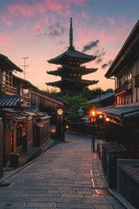 The colors of sunset burst behind the pagoda of Yasaka Shrine in Kyoto, Japan